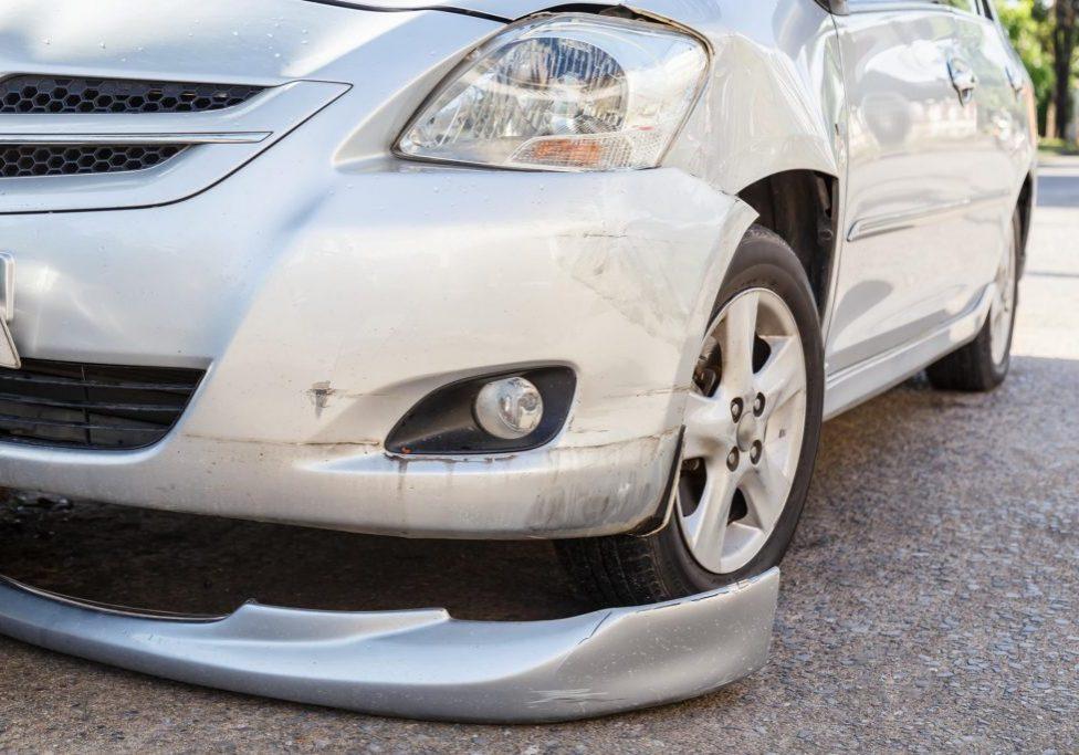 a crashed bumper of the car